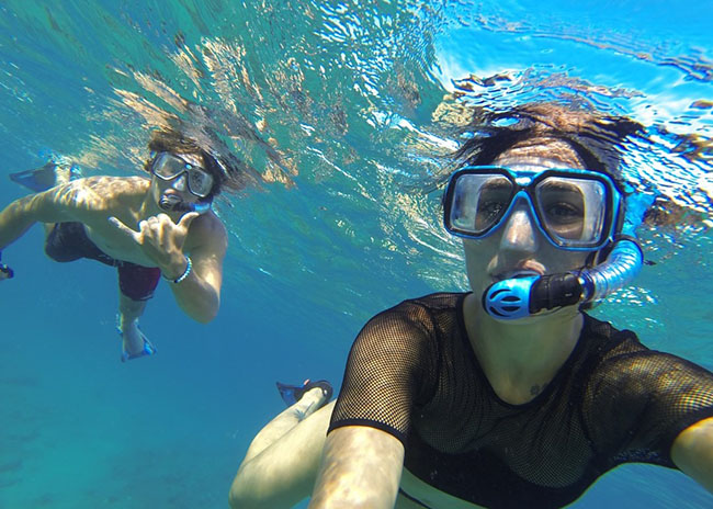 Lina and her boyfriend snorkeling around the island.